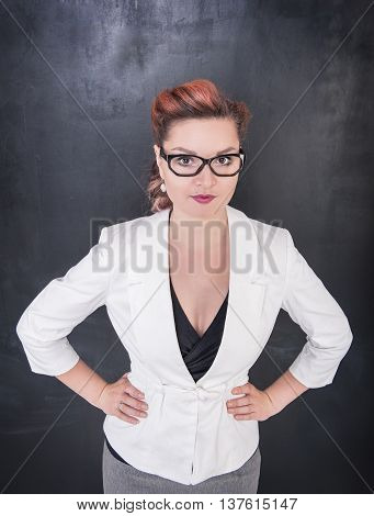 Beautiful Teacher On Blackboard Background
