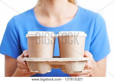 Close Up Of Woman Holding Tray Of Takeaway Coffee