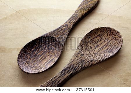 Pair of Wooden Cooking Spoons on Wooden Background
