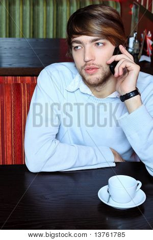 Young business man having a break at a cafe