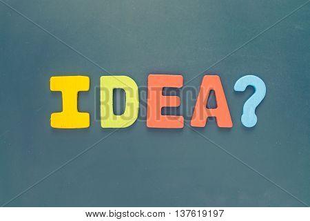 Colorful text IDEA? wording on blackboard - uppercase letter IDEA word on chalkboard