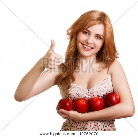 Young happy smiling woman with four red apple isolated on white