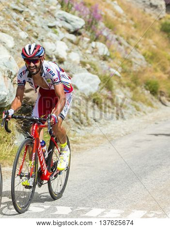 Col de la Croix de Fer France - 25 July 2015:The Italian cyclist Giampaolo Caruso of Katusha Team climbing to the Col de la Croix de Fer in Alps during the stage 20 of Le Tour de France 2015.
