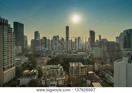 cityscape on backlit nearly sunset blue sky