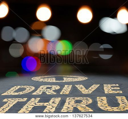 combination of drive thru sign and bokeh light abstract