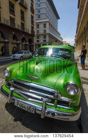 HAVANA - CUBA JUNE 13, 2016: Close-up of a restored 1949 Chevrolet taxi waiting for passengers outside the Parque Central Hotel in La Habana Vieja. There are thousands of classic cars in Havana that were purchased prior to the American embargo on Cuba