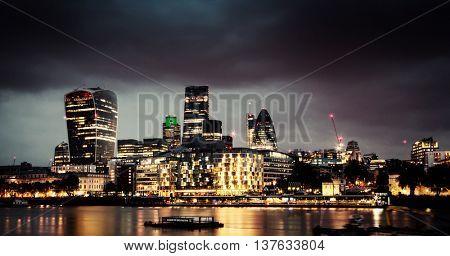 LONDON, UK JUNE 10, 2016 - A long exposure shot of Skzscrapers in the City at Night
