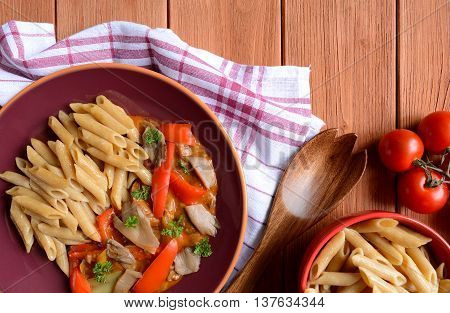 Stewed oyster mushrooms with peppers and whole wheat pasta
