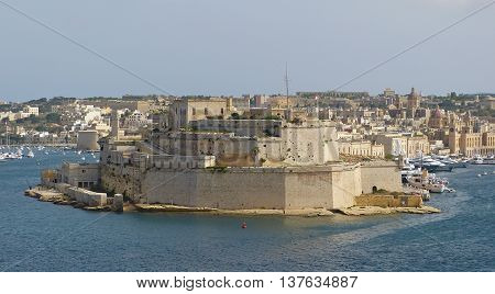 Vittoriosa, Malta - September 29, 2013. Fort St Angelo in Vittoriosa, with Grand Harbor, Vittoriosa city view, yachts and boats in the distance.