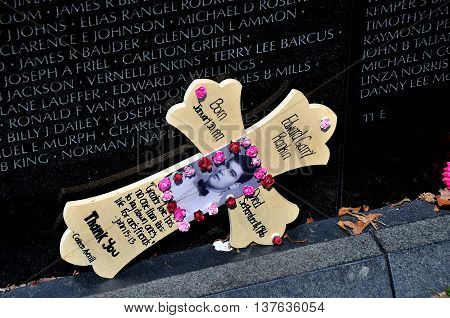 Washington DC - April 10 2014: Tribute to a fallen soldier at the Vietnam War Memorial on the National Mall *