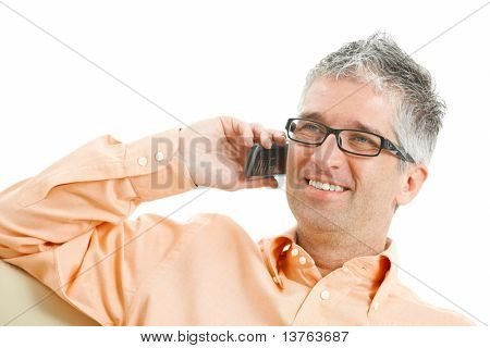 Casual man wearing jeans and orange shirt talking on mobile phone. Isolated on white.?