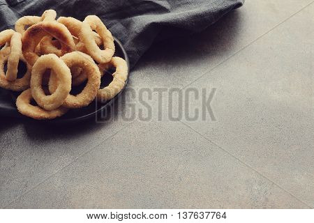 Fast food. Onion rings on the table