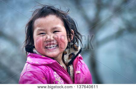 HA GIANG, VIETNAM, February 14, 2016 baby girl, ethnic Hmong, Ha Giang mountainous region, Vietnam, friendly smile