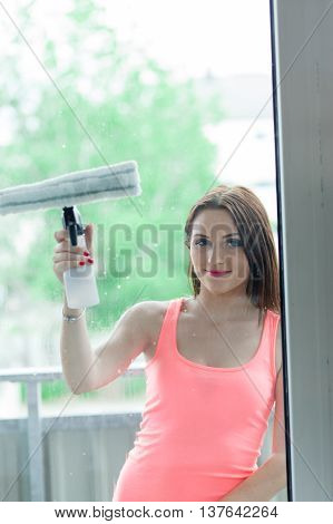 The Girl Washes The Windows.