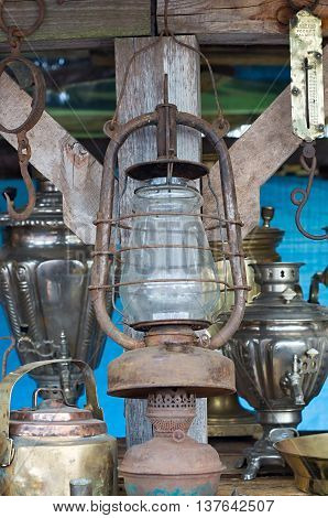 old household items: a lamp and samovars