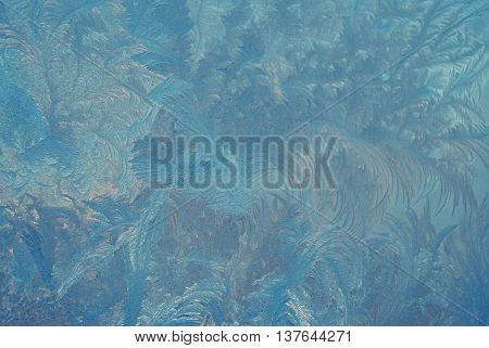 Fantastic abstract winter background (frost pattern on a window glass) retro style