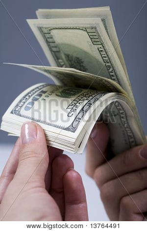 Human hands counting one hindered dollars banknotes