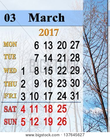 calendar for March 2017 with trees in the early spring