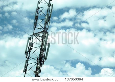 Tower with Cellular (Mobile) Equipment on Cloudy Sky Background. Communication Concept