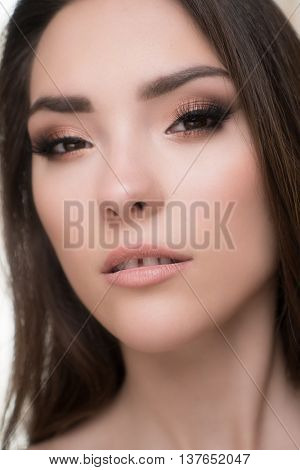 Closeup of beautiful brunette woman with pretty eyes and gap between teeth