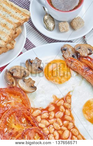 Traditional full English breakfast on a table. Daily breakfast
