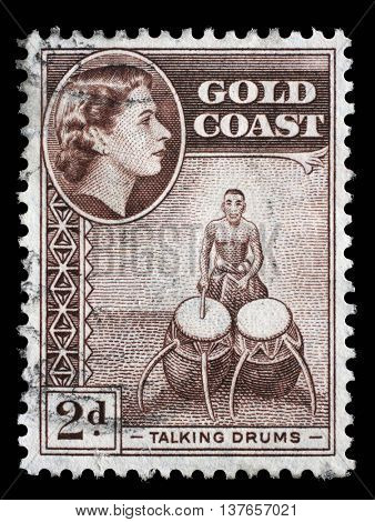 ZAGREB, CROATIA - SEPTEMBER 18: stamp printed in Ghana shows talking drums and queen Elizabeth II, stamp of Gold Coast overprinted, Ghana Independence, circa 1957, on Sep 18,2014, Zagreb, Croatia