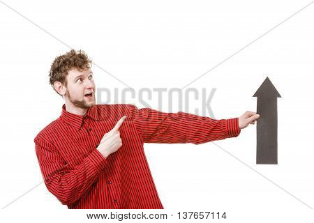 Make choice concept. Elegant man in red with big black arrow sin symbol pointing. Young guy present show right direction to decide and solve problems.