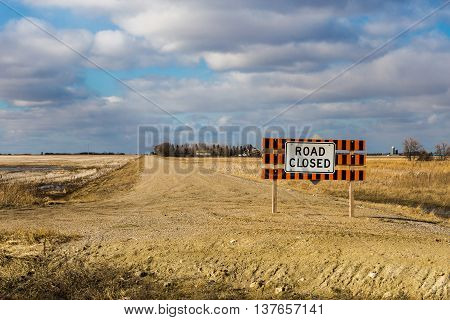 Road closed sign on a rural country road.