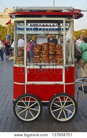 Istanbul Turkey -September 9 2012: A vendor sells simit a type of Turkish bread in the streets of Istanbul.