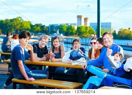 Multiethnic group of young people enjoying the outdoors at lakeside park