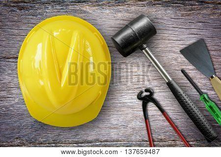 Plastering trowel, hammer, screwdriver,Cream wire cutter,helmet on the wooden floor