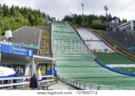 LILLEHAMMER, NORWAY - JUNE 27: Training ski jumpers, who are preparing for the summer competitions on June 27, 2016 in Lillehammer, Norway. Lillehammer is the center of winter sports.