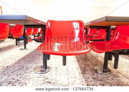 This auditorium is in the university whit red chairs