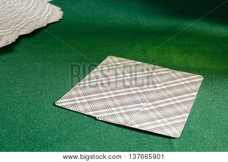 Playing cards on the table with green felt poker