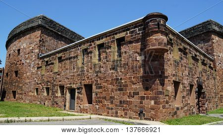 NEW YORK, NY - JUN 19: Castle Williams on Governors Island in New York Harbor, as seen on Jun 19, 2016. Castle Williams has three levels of casemates for 103 cannon gun in its three levels and roof.