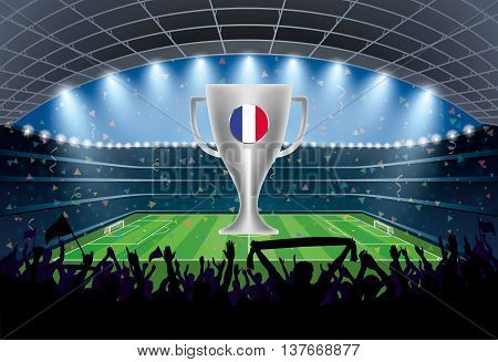 Trophy With France Flag And Excited Crowd Of People At A Soccer Stadium.