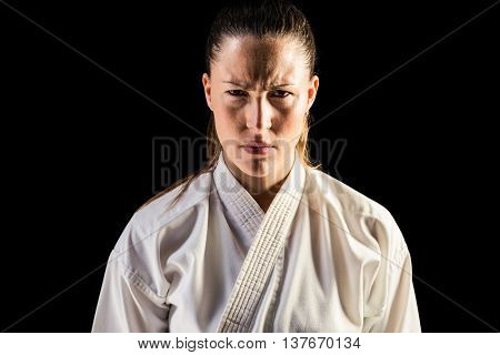 Female fighter posing black background