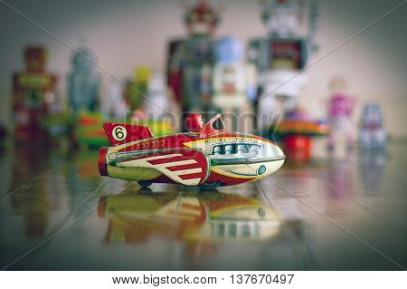 retro vintage rocket toy on wooden floor
