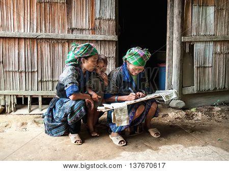 YEN BAI, VIETNAM, June 13, 2016 ethnic Hmong women's group, highland Yen Bai, hard writing