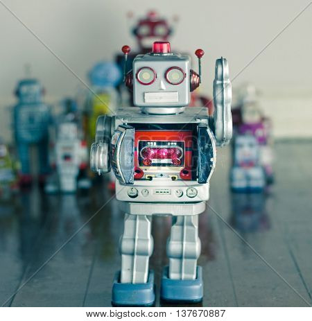 silver robot toy on wooden floor