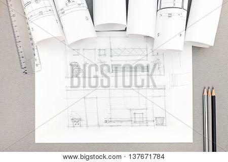 Architectural Hand-drawn Sketch With Blueprint Rolls On Desktop