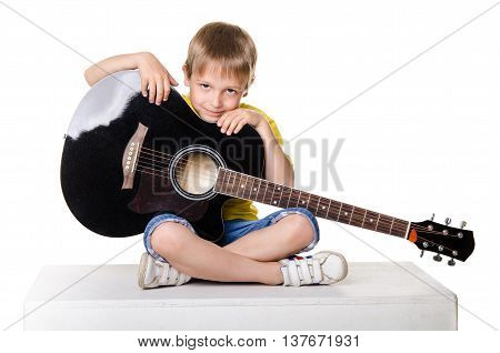 Boy Sitting With Guitar In Lotos Pose Isolated On A Over White Background