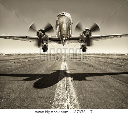 take off of an old airplane from the runway