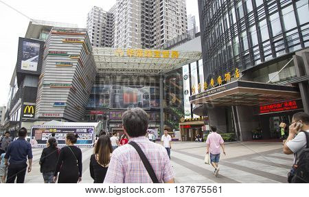 Shenzhen, China - Jun 15, 2016: Chinese people walking to a shopping center mall selling many kinds of Made in China goods and digital products.