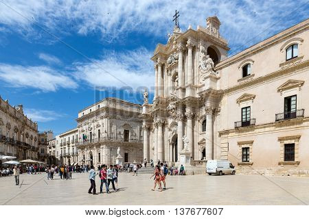 SIRACUSA ITALY - MAY 18: Tourists wondering baroque style Piazza Duomo and Cathedral on May 18 2016 in Syracusa at the island Sicily Italy