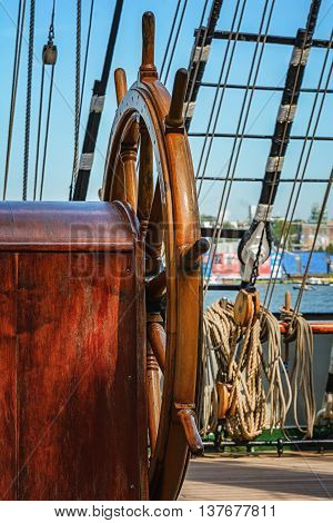 The rudder and rigging aboard of a sail ship