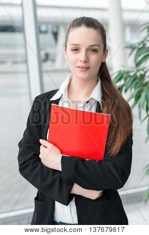 Succesful Confident Business Woman Holding Folder