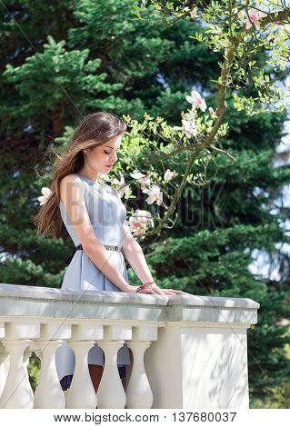Beautiful Girl Near Magnolia Tree