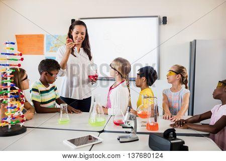 A teacher teaching a science lesson in classroom