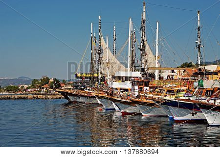 Turkish gulet cruise boats in harbor on a summers day